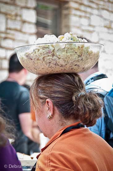 Pok-E-Jo's BBQ server balancing potato salad bowl
